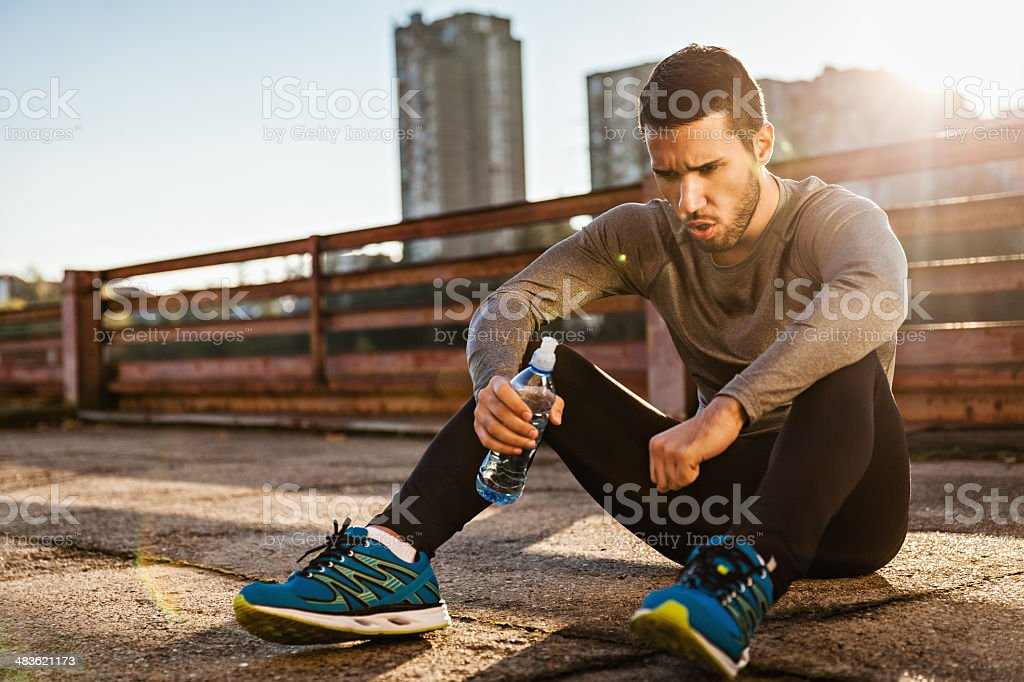 Man resting after workout stock photo