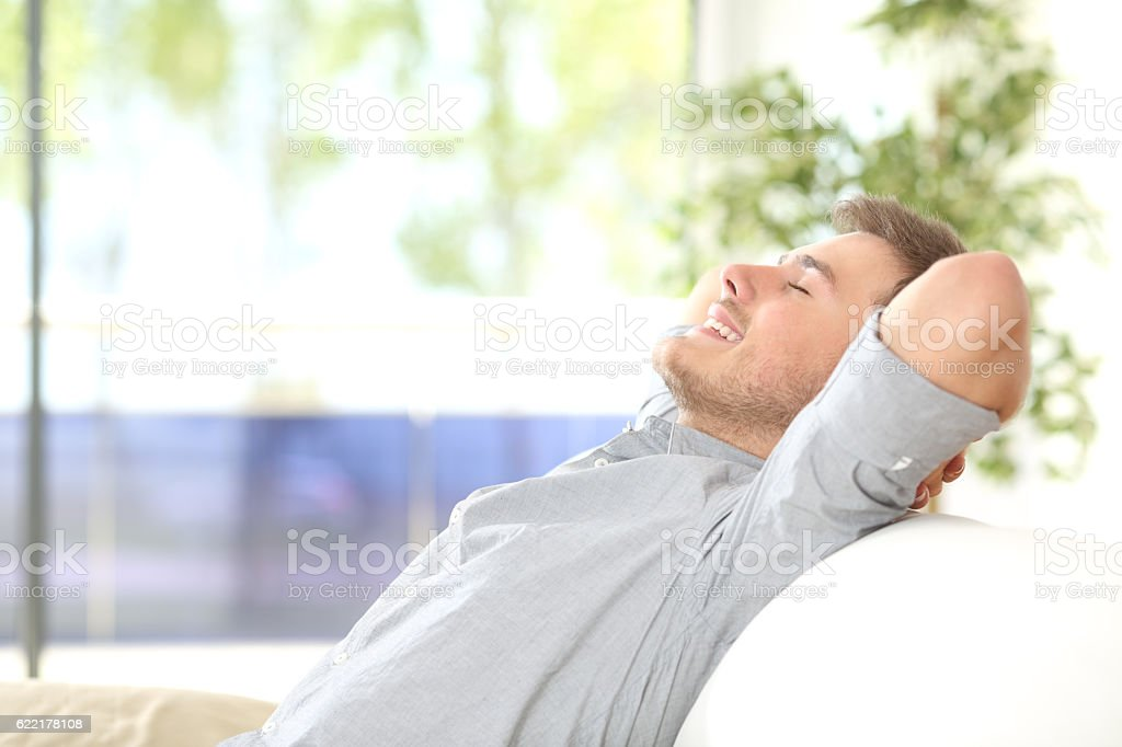 Man resting and breathing at home stock photo