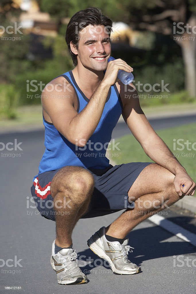 Man Resting And Drinking Water After Exercise royalty-free stock photo