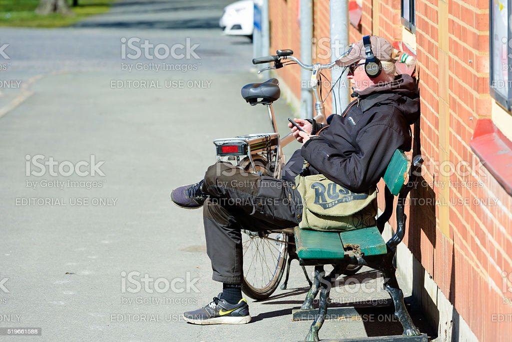 Man resting and listening stock photo