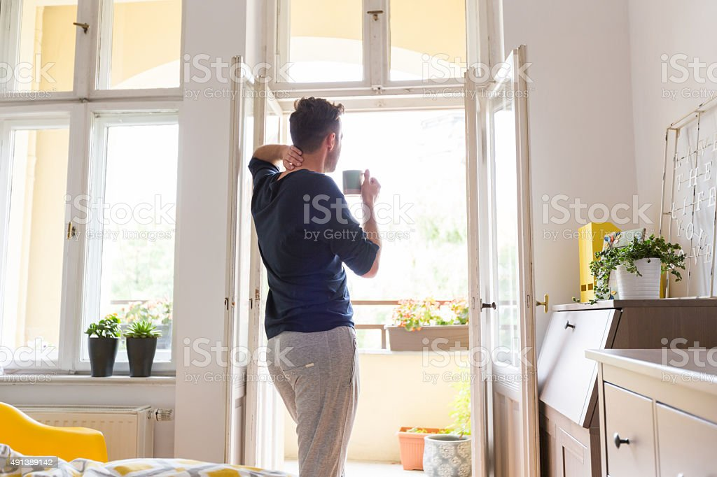 Man resting at home in the morning stock photo