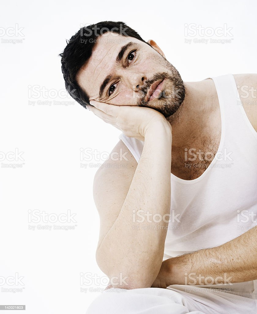 Man resting head in hands stock photo
