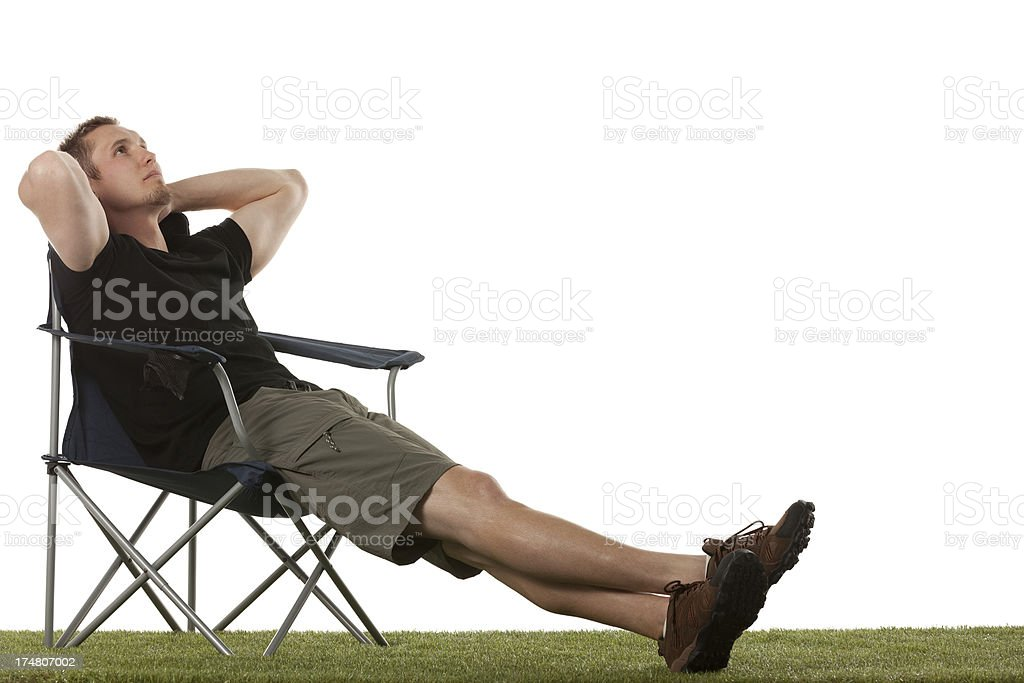 Man resting in a folding chair royalty-free stock photo