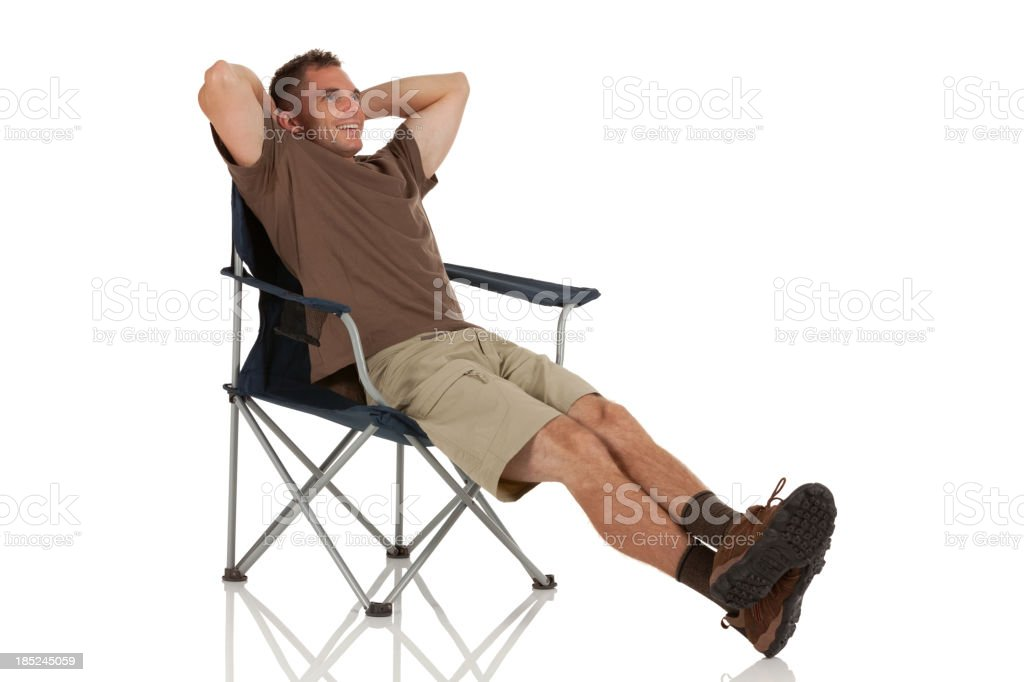 Man resting in a folding chair stock photo