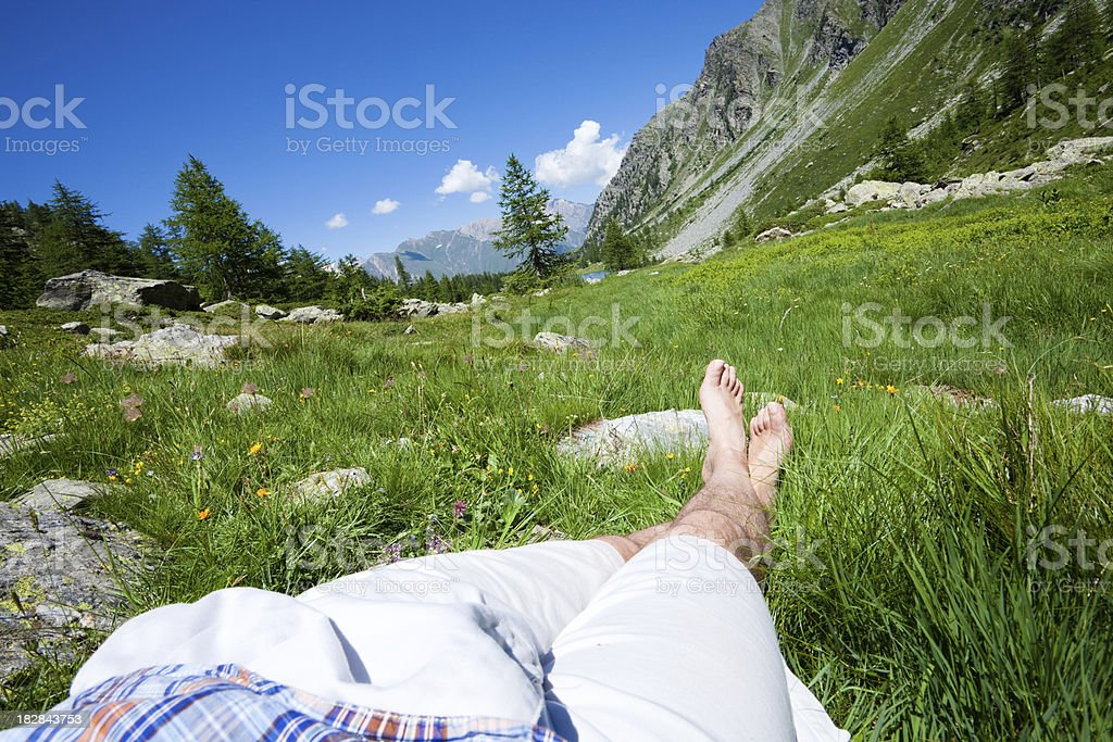 Man resting  in the Italian Alps royalty-free stock photo