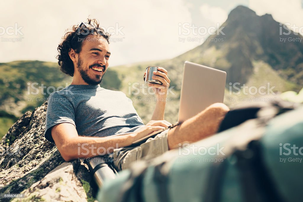 Man resting in the mountain stock photo