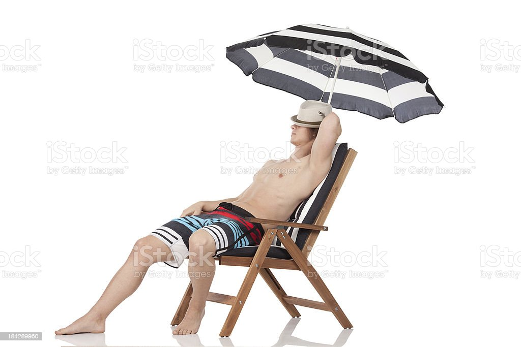 Man resting on a beach chair royalty-free stock photo