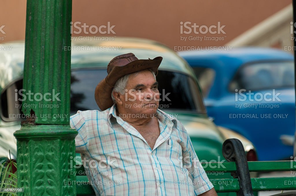 Man resting on a bench in Santiago de Cuba stock photo