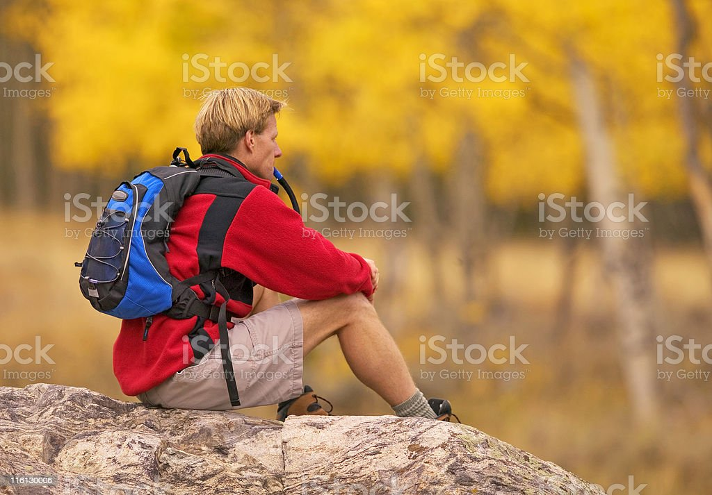 Man Resting On A Boulder In Colorado stock photo