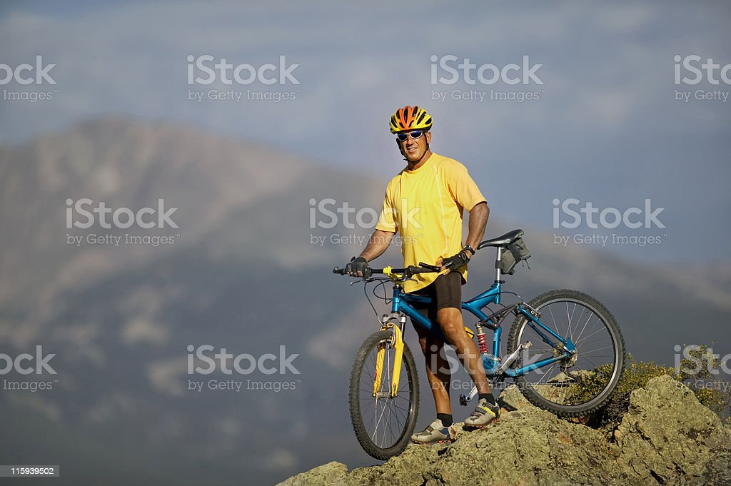 Man Resting on Bicycle with Mountain View royalty-free stock photo