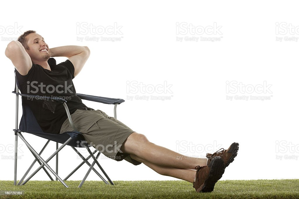 Man resting on chair in a lawn royalty-free stock photo