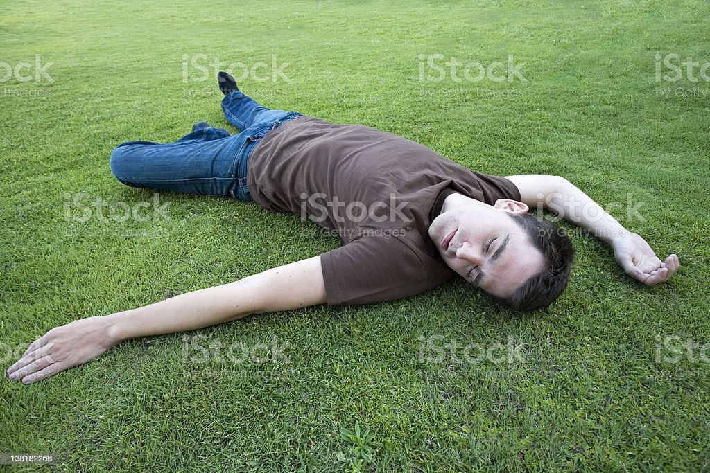 Man resting on grass royalty-free stock photo