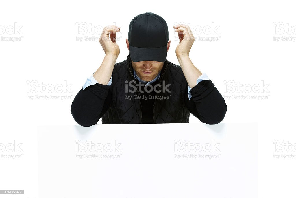 Man resting on placard and looking down royalty-free stock photo