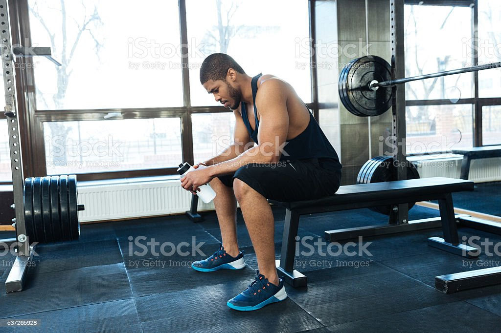Man resting on the bench stock photo