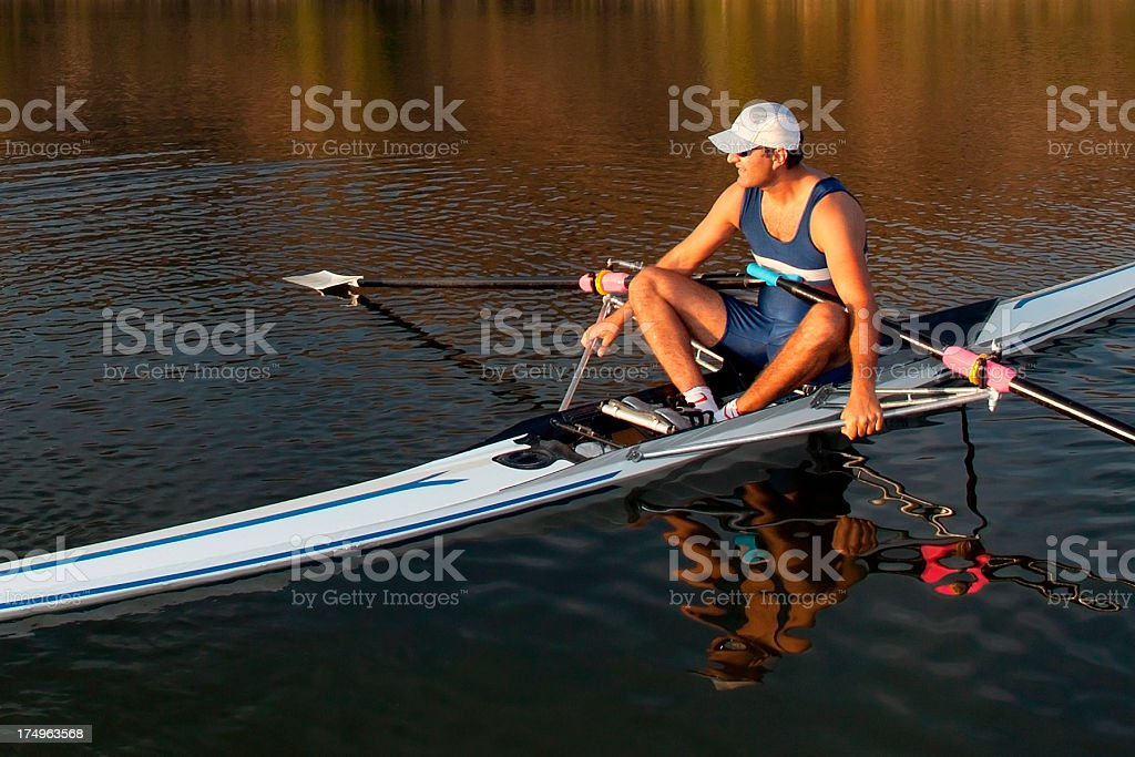 Man resting on the boat at sunset stock photo