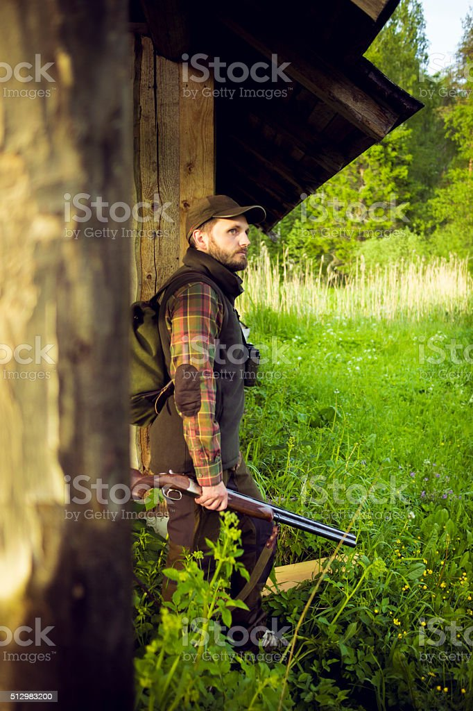 Man Resting Outside His Summerhouse After A Day Spent Outdoors stock photo