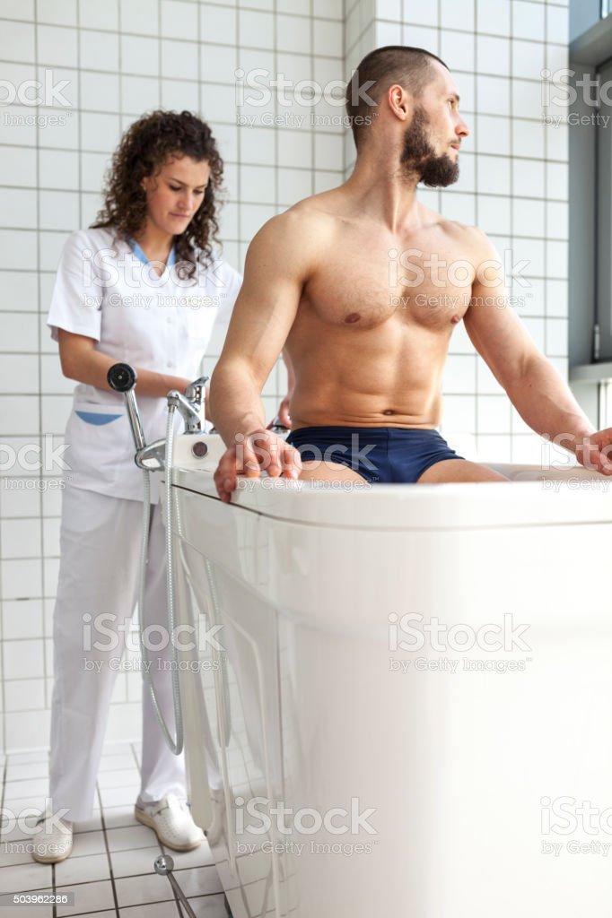 Man Reveiving Legs Hydromassage stock photo