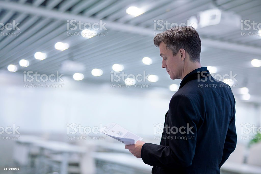 Man reviewing document in learning classroom for presentation stock photo