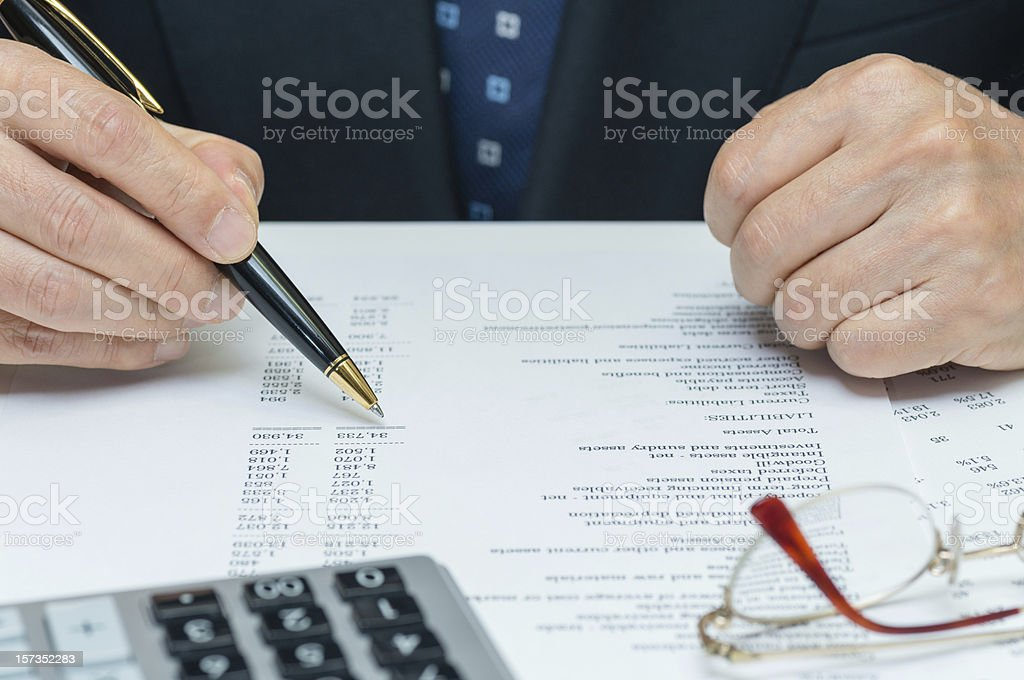 Man reviewing financial reports stock photo