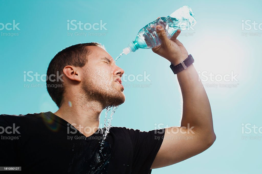 A man revitalizing himself after a run stock photo