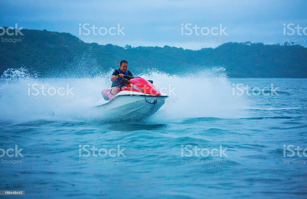 man ridding a jet ski royalty-free stock photo