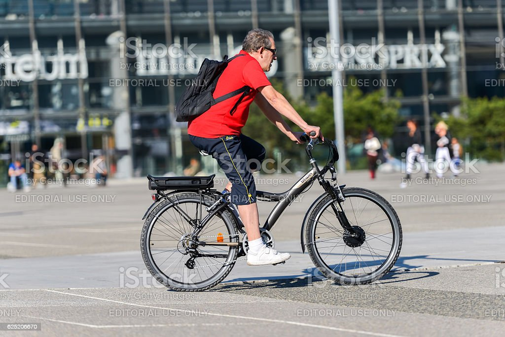Man ride a bike in town. Alternative ecological  transport stock photo