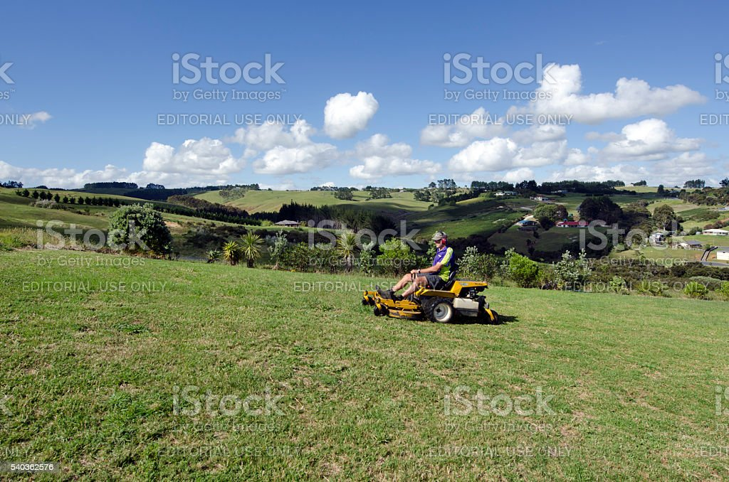 Man ride on lawn mower stock photo