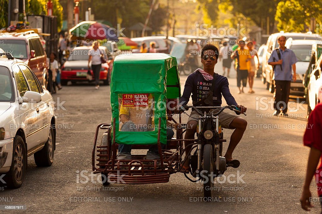 Man rides a motorcycle and sidecar, Manila, Philippines stock photo