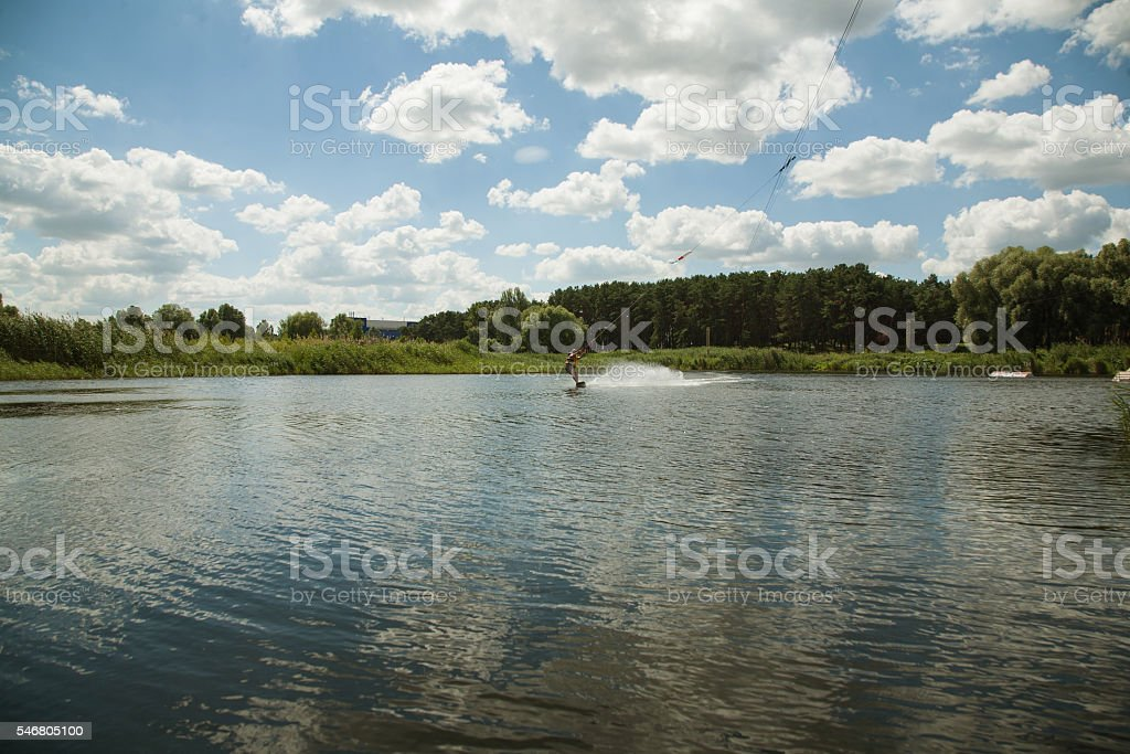 man rides a wakeboard stock photo