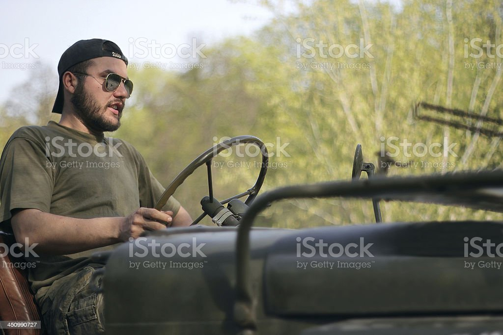man rides an old jeep stock photo
