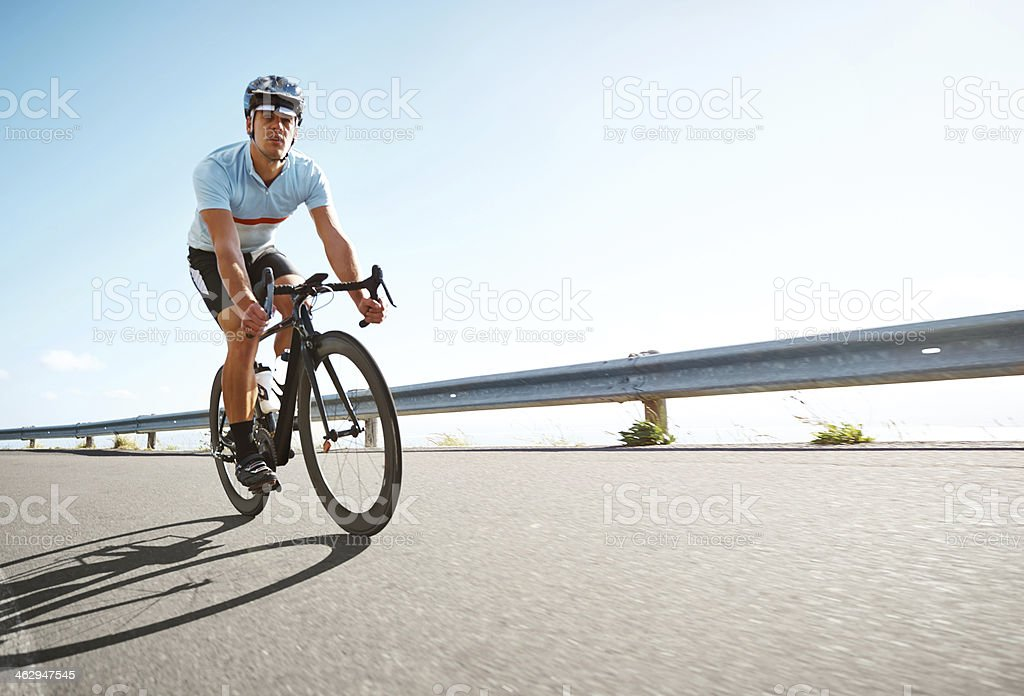 Man riding a bicycle on scenic road stock photo