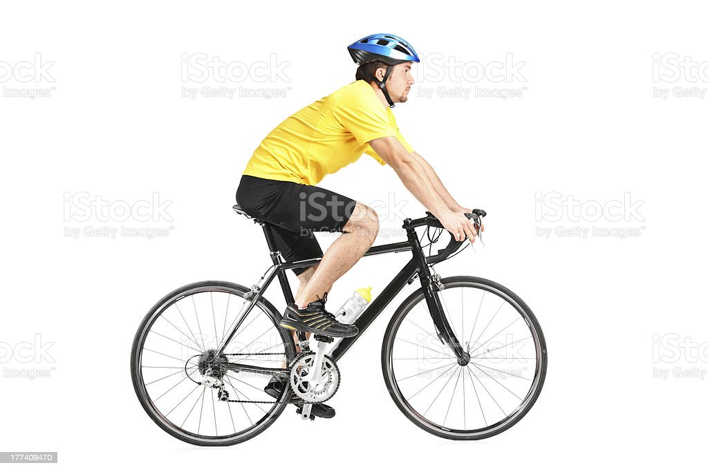 Man riding a bycicle stock photo