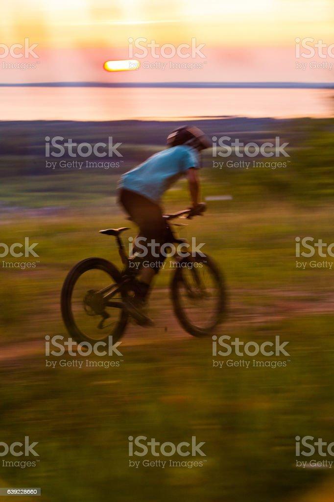 Man riding a downhill enduro bike on single track stock photo