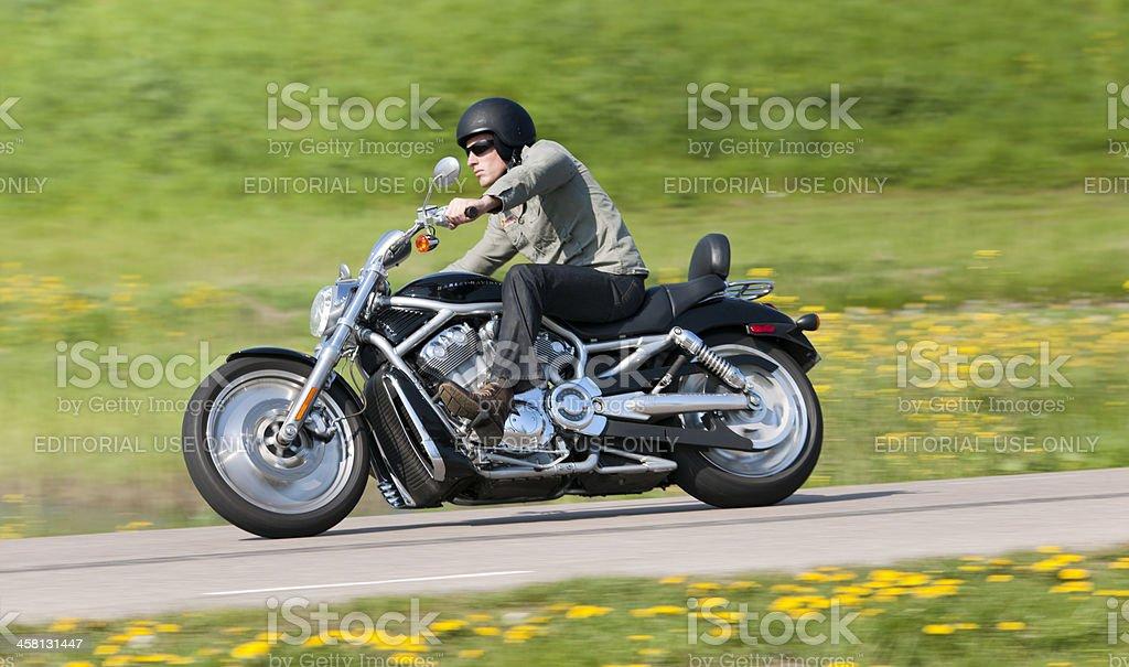 man riding a Harley Davidson stock photo