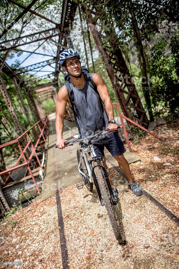 Man riding a mountain bike outdoors stock photo