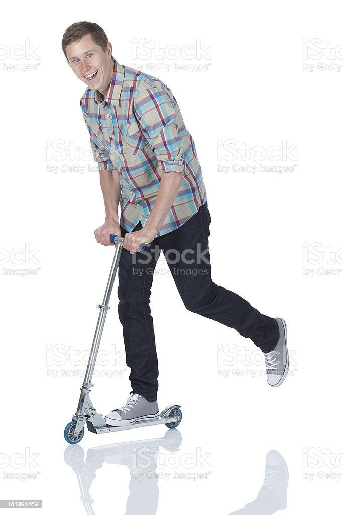 Man riding a push scooter royalty-free stock photo