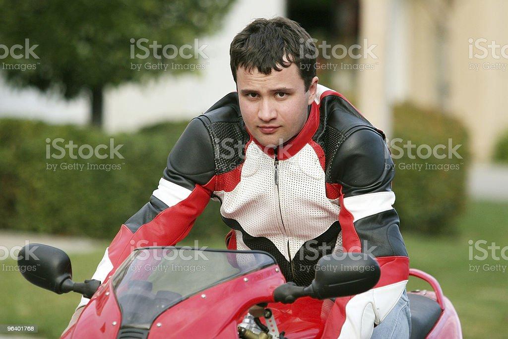 Man riding a red bike royalty-free stock photo