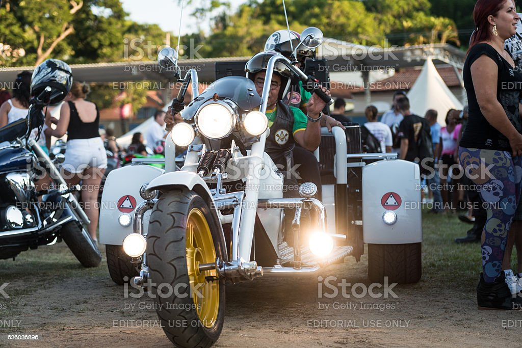 Man riding a tricycle with lights on, chopper festival stock photo