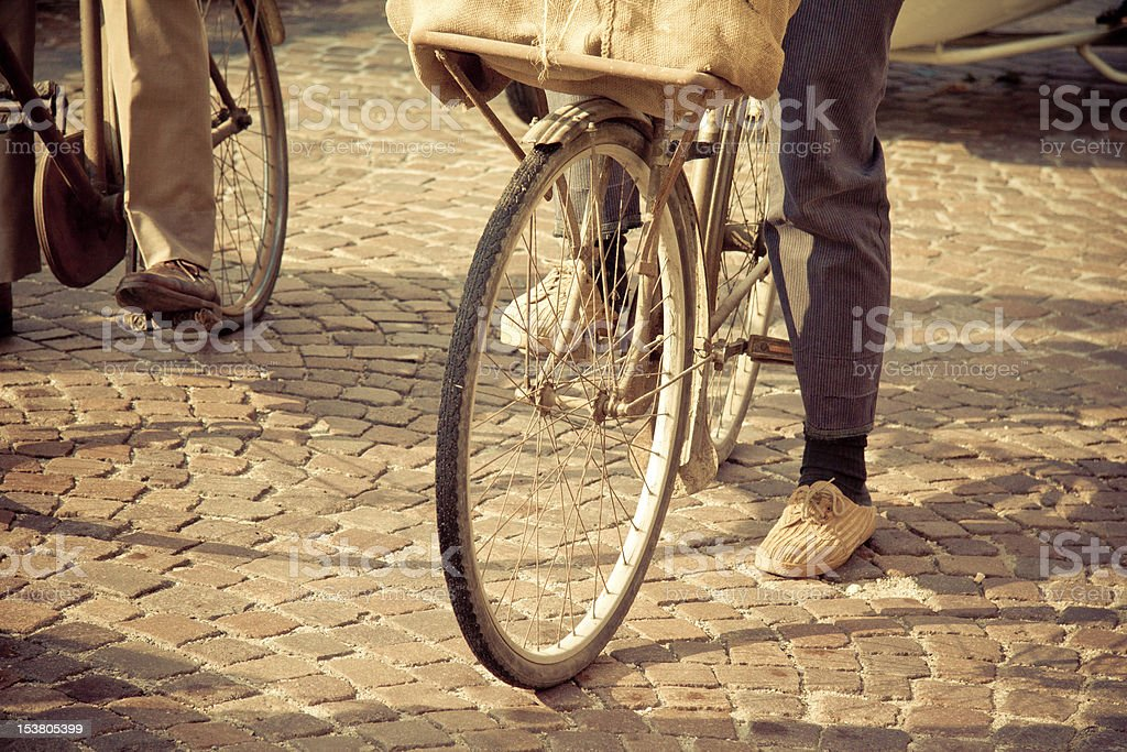 Man riding a vintage bicycle royalty-free stock photo