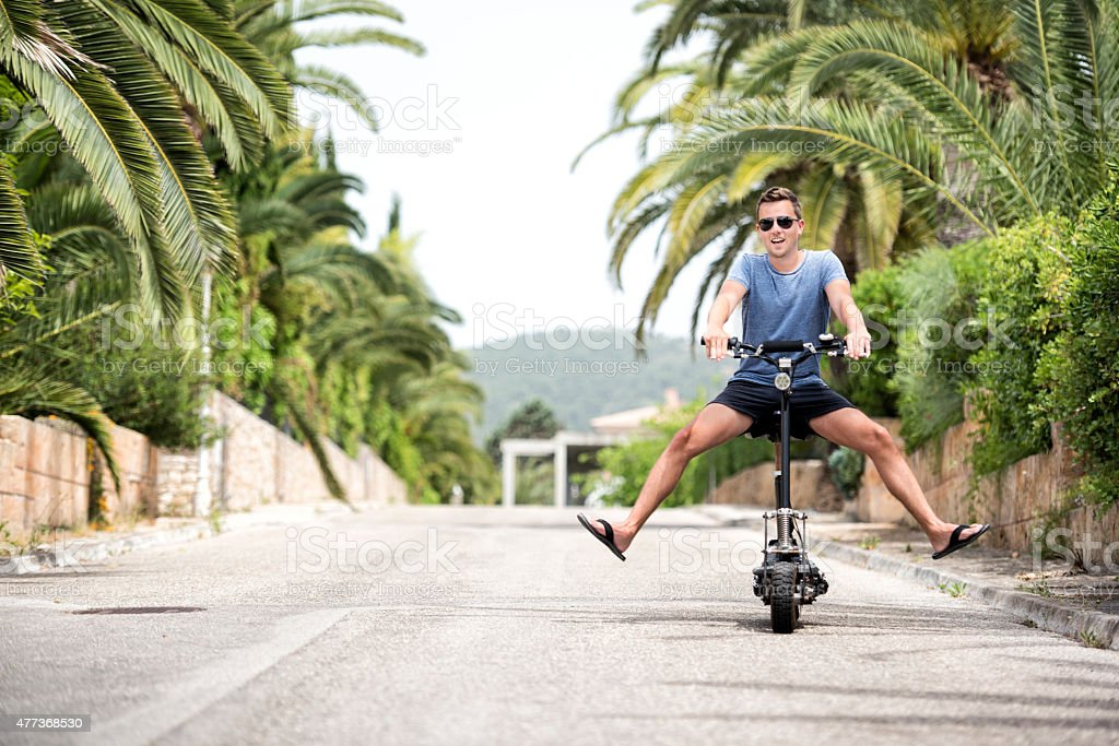 Man riding an Electric Scooter stock photo