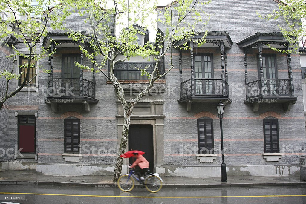 Man Riding Bicycle In Rainstorm royalty-free stock photo
