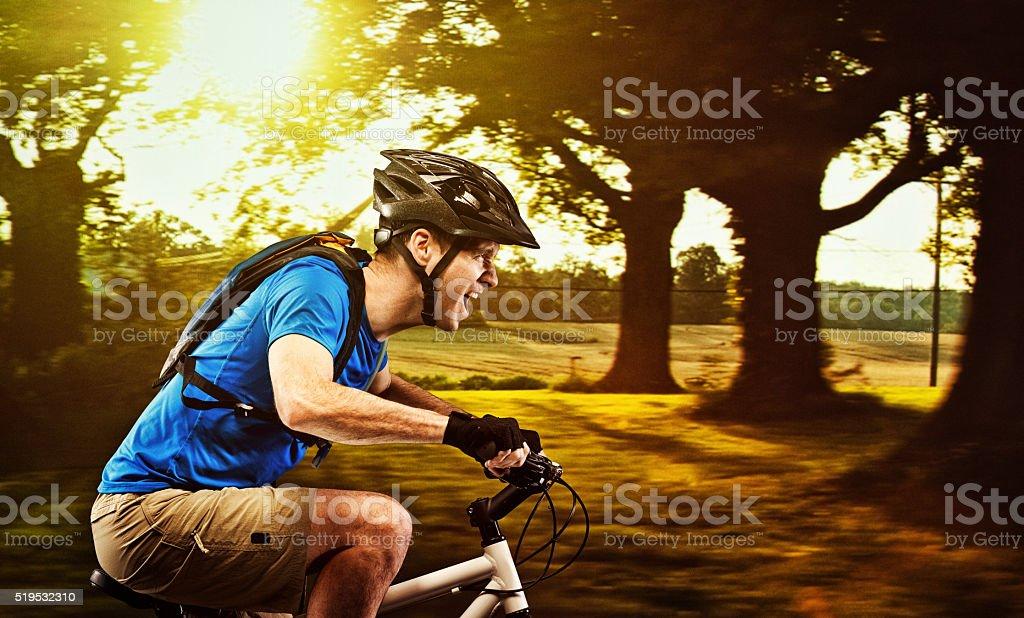Man riding bicycle stock photo