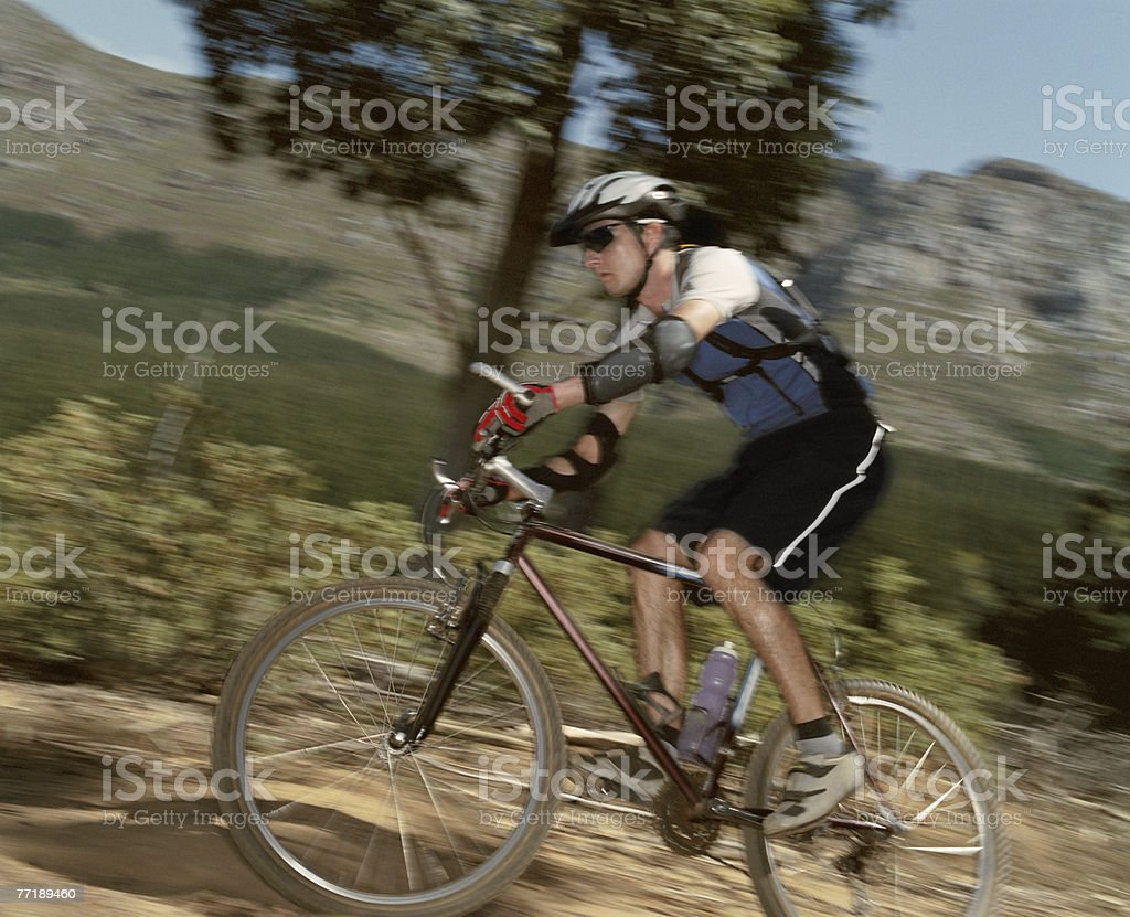 A man riding his bike on a trail royalty-free stock photo