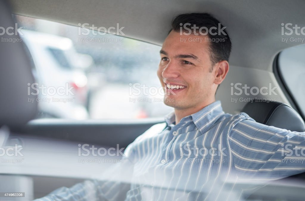 Man riding in a car stock photo