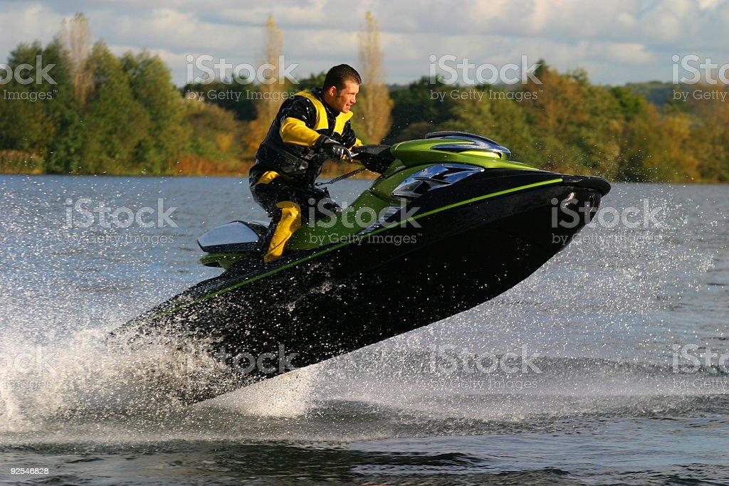 Man Riding Jet Ski Wet Bike Personal Watercraft stock photo