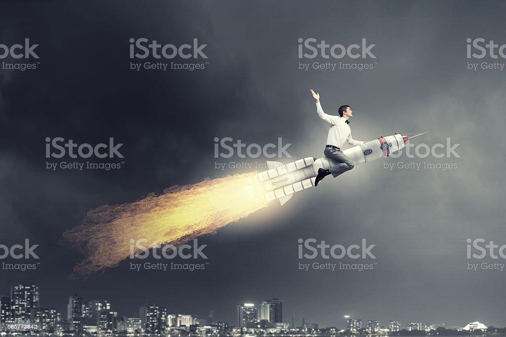 Man riding missile . Mixed media stock photo