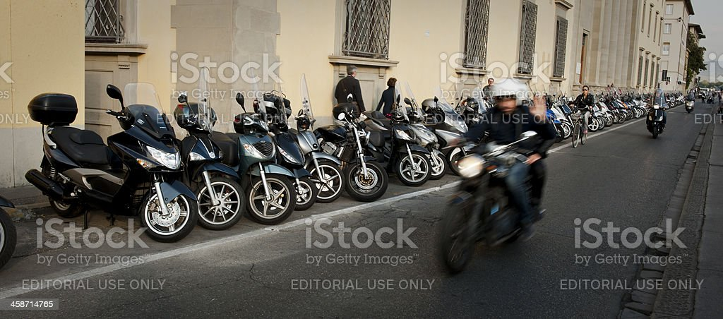 man riding motorcycle in Florence Italy stock photo