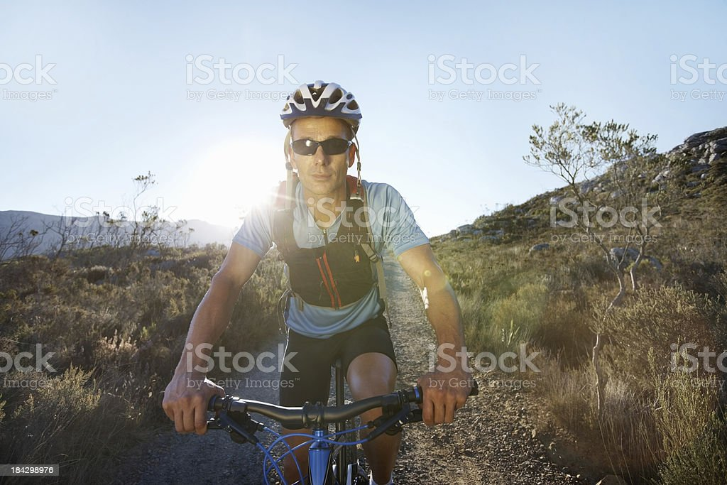 Man riding mountain bike on gravel path royalty-free stock photo
