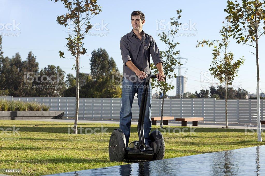 Man riding on segway. stock photo