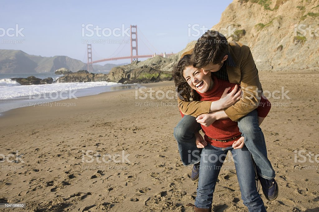 Man riding piggyback stock photo